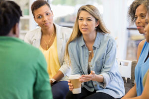 Counselor gives advice during group therapy session
